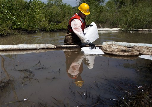 Worker cleans up the aftermath of the oil spill on the Yellowstone River.