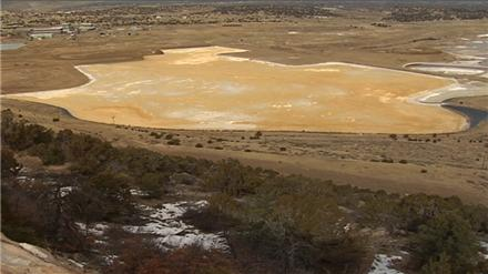 Managers of a uranium mill want to stop testing the acidity of a leaking radioactive-waste impoundment pond because conditions have become too dangerous for workers.