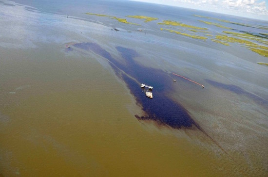 Two vessels deploy a boom to capture an estimated 4,200 gallons of crude oil near Lake Grande Ecaille in Barataria Bay, LA. Photo by NOLA.com