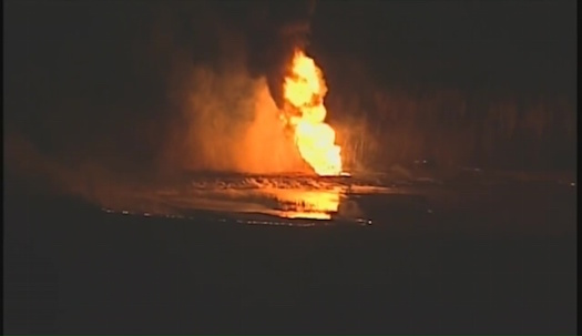 Flames from a pipeline explosion Tuesday night near Kansas City, MO.