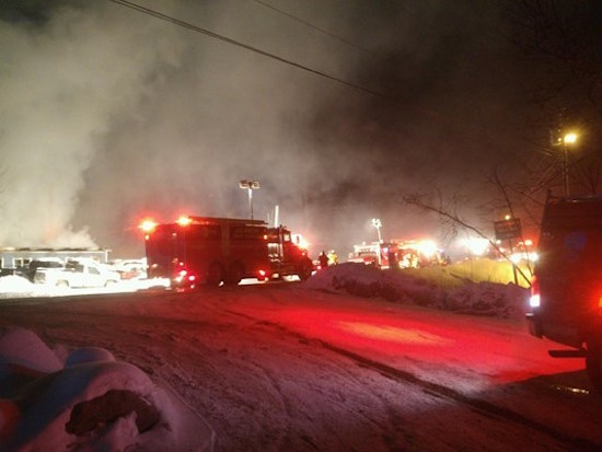 Firefighters work to put out a fire at a Liberty, ME, manufacturing facility, which ended up a total loss.
