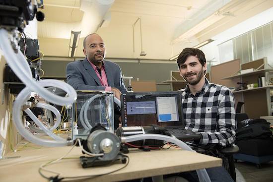 Georgia Tech researchers developed a new form of ransomware that can take control of a system. They simulated a water treatment plant and highlighted vulnerabilities in the control systems. Raheem Beyah, left, associate chair in the Georgia Tech School of Electrical and Computer Engineering, and David Formby, right, a Georgia Tech Ph.D. student, led the research.  Photo by Christopher Moore, Georgia Tech